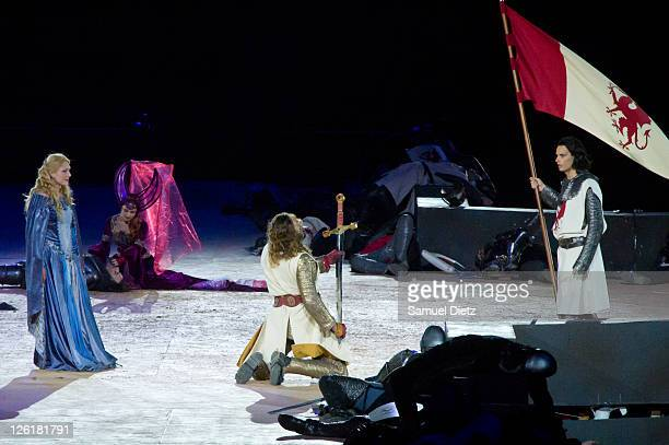 Nathalie Pujol as Guinevere Sophie Tellier as Morgane La Fay and Ludovic Gorva as King Arthur perform during the final rehearsal of 'Excalibur The...