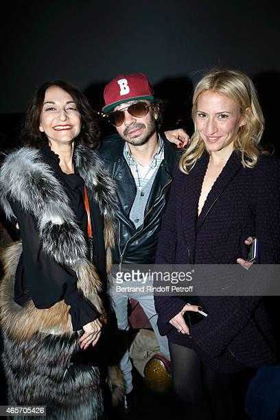 Nathalie Rykiel, Olivier Zahm and Lola Burstein attend the Saint Laurent show as part of the Paris Fashion Week Womenswear Fall/Winter 2015/2016 on...
