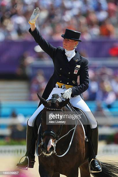 Nathalie Zu Sayn Wittgenstein of Denmark riding Digby reacts during the Individual Dressage on Day 13 of the London 2012 Olympic Games at Greenwich...