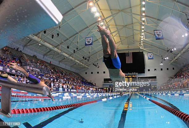 Nathan Adrian dives in on his way to winning the men's 100m freestyle finals during day 1 of the 2013 USA Swimming Phillips 66 National Championships...