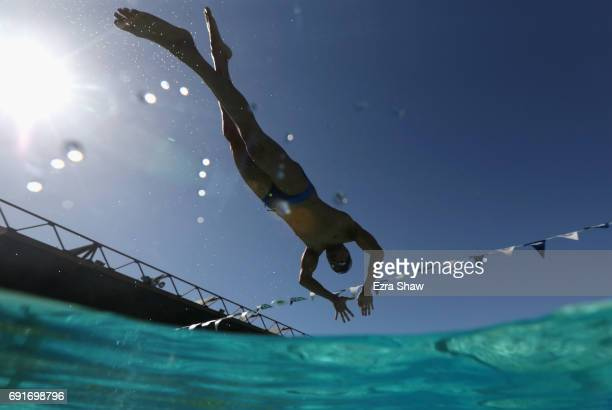 Nathan Adrian dives in to warm up before the Finals during Day 2 of the 2017 Arena Pro Swim Series at George F Haines International Swim Center on...