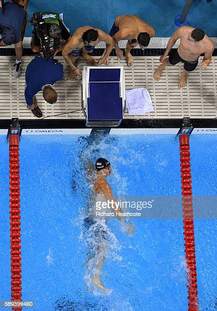 Nathan Adrian of the United States touches the wall wo win gold in the Men's 4 x 100m Medley Relay Final on Day 8 of the Rio 2016 Olympic Games at...