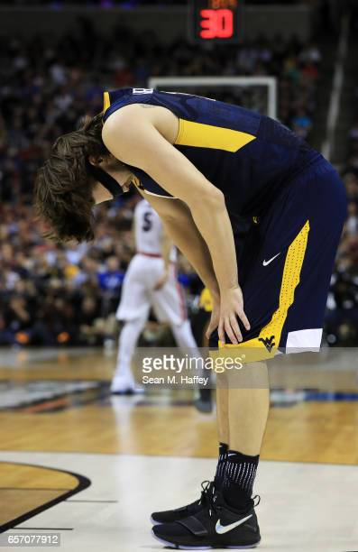 Nathan Adrian of the West Virginia Mountaineers reacts to their 58 to 61 loss to the Gonzaga Bulldogs during the 2017 NCAA Men's Basketball...
