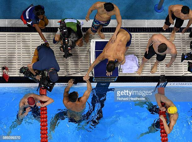 Nathan Adrian, Ryan Murphy, Michael Phelps and Cody Miller of the United States celebrate winning gold in the Men's 4 x 100m Medley Relay Final on...