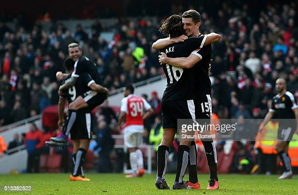 Nathan Ake and Craig Cathcart of Watford celebrate victory after the Emirates FA Cup sixth round match between Arsenal and Watford at Emirates...