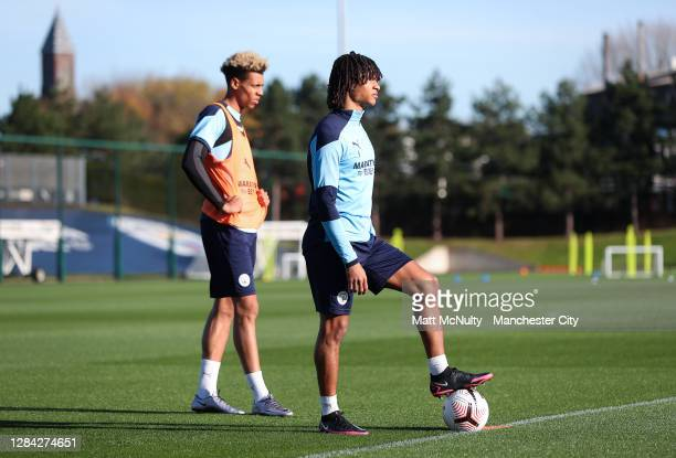 Nathan Ake and Felix Nmecha of Manchester City in action during a training session at Manchester City Football Academy on November 06, 2020 in...