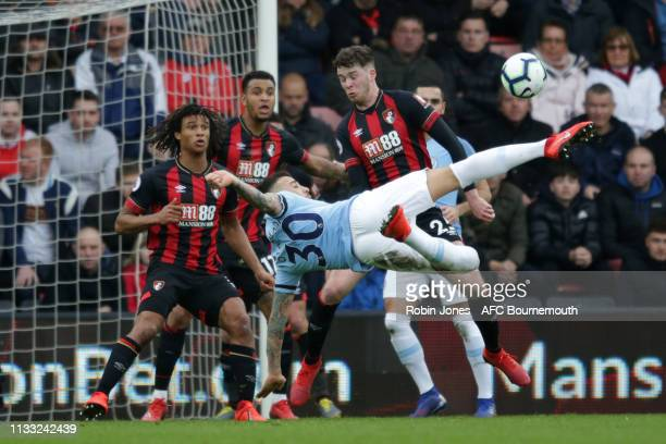 Nathan Ake and Jack Simpson come out to block Nicolas Otamendi of Manchester City during the Premier League match between AFC Bournemouth and...