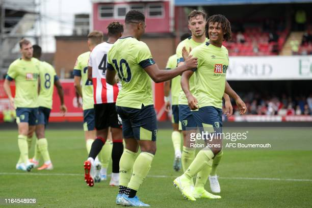Nathan Ake congratulates Jordon Ibe of Bournemouth after he scores a goal to make it 1-0 during the Pre-Season Friendly match between Brentford and...