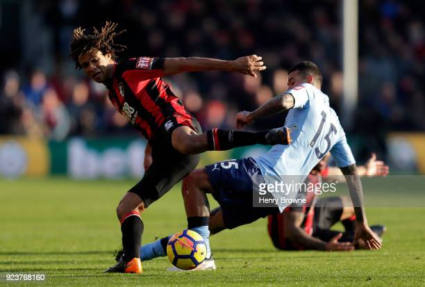 Nathan Ake of AFC Bournemouth and Kenedy of Newcastle United battle for the ball during the Premier League match between AFC Bournemouth and...