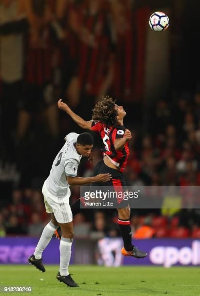 Nathan Ake of AFC Bournemouth and Marcus Rashford of Manchester United battle for possession in the air during the Premier League match between AFC...