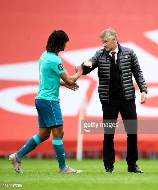 Nathan Ake of AFC Bournemouth and Ole Gunnar Solskjaer, Manager of Manchester United elbow bump following the Premier League match between Manchester...