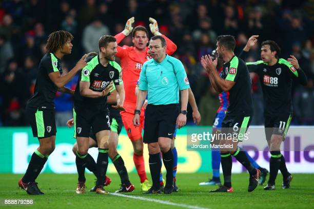 Nathan Ake of AFC Bournemouth and Simon Francis of AFC Bournemouth react as referee Kevin Friend awards Crystal Palace a penalty during the Premier...