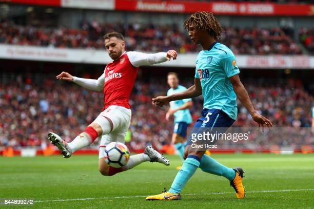 Nathan Ake of AFC Bournemouth attempts to cross as Aaron Ramsey of Arsenal attempts to block during the Premier League match between Arsenal and AFC...