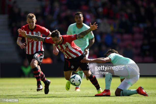 Nathan Ake of AFC Bournemouth battles for possession with Danny Ings of Southampton during the Premier League match between Southampton FC and AFC...