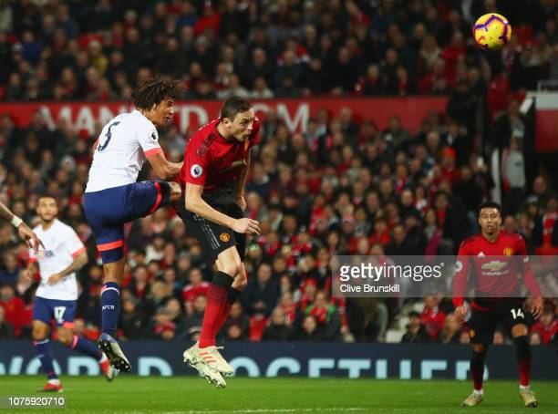 Nathan Ake of AFC Bournemouth beats Nemanja Matic of Manchester United as he scores his team's first goal during the Premier League match between...