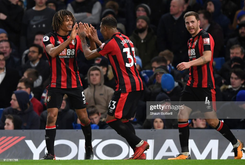 Nathan Ake of AFC Bournemouth celebrates after scoring his sides third goal with Jordon Ibe of AFC Bournemouth during the Premier League match between Chelsea and AFC Bournemouth at Stamford Bridge on January 31, 2018 in London, England.