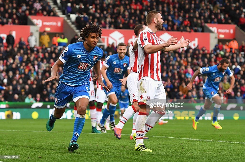 Nathan Ake of AFC Bournemouth (L) celebrates scoring his sides first goal during the Premier League match between Stoke City and AFC Bournemouth at Bet365 Stadium on November 19, 2016 in Stoke on Trent, England.