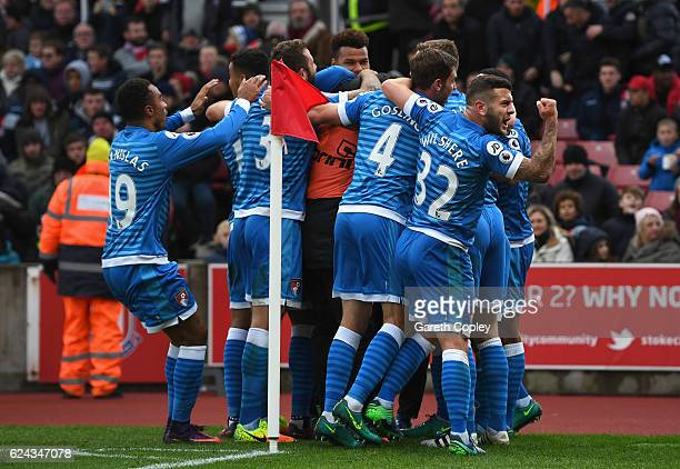 Nathan Ake of AFC Bournemouth celebrates scoring his sides first goal with his AFC Bournemouth team mates during the Premier League match between...