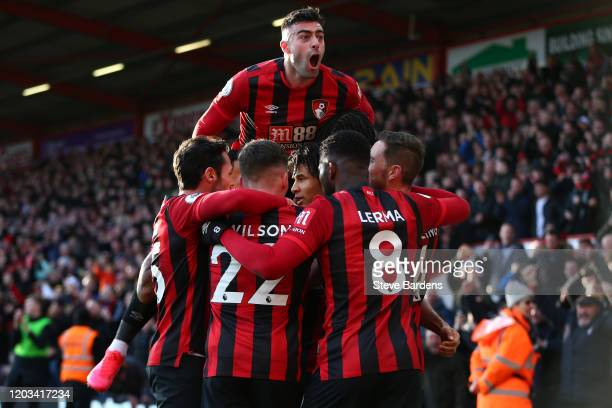 Nathan Ake of AFC Bournemouth celebrates with his team mates after scoring his team's second goal as Diego Rico of AFC Bournemouth jumps up in...