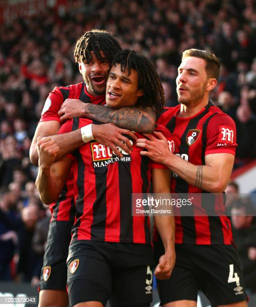 Nathan Ake of AFC Bournemouth celebrates with Philip Billing and Dan Gosling after scoring his team's second goal during the Premier League match...