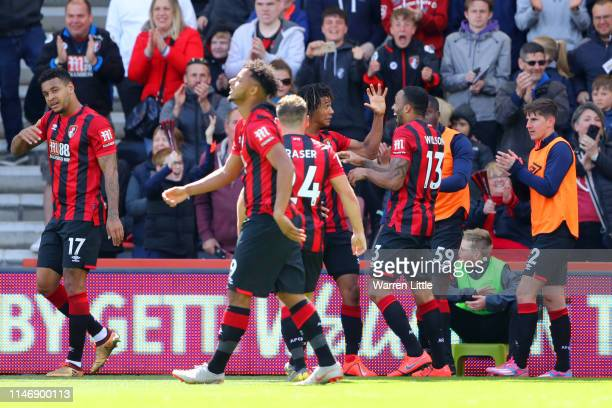 Nathan Ake of AFC Bournemouth celebrates with teammates after scoring his team's first goal during the Premier League match between AFC Bournemouth...
