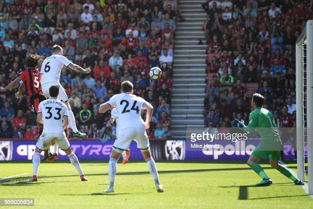 Nathan Ake of AFC Bournemouth heads the ball during the Premier League match between AFC Bournemouth and Swansea City at Vitality Stadium on May 5...