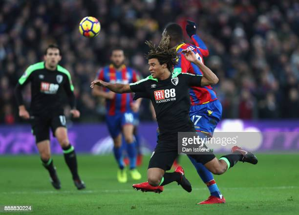 Nathan Ake of AFC Bournemouth is challenged by Christian Benteke of Crystal Palace during the Premier League match between Crystal Palace and AFC...