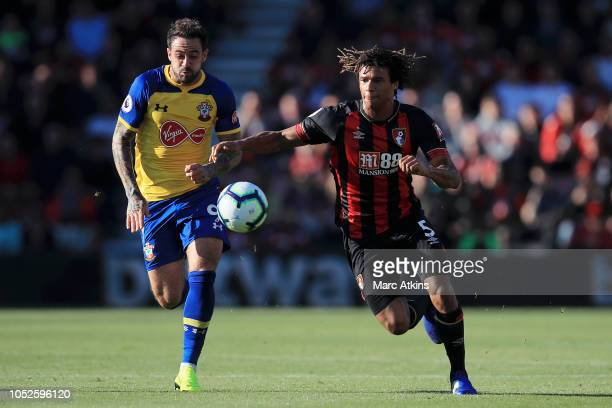 Nathan Ake of AFC Bournemouth is challenged by Danny Ings of Southampton during the Premier League match between AFC Bournemouth and Southampton FC...