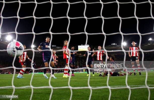 Nathan Ake of AFC Bournemouth leaps above Kevin Danso of Southampton to score his sides first goal during the Premier League match between...