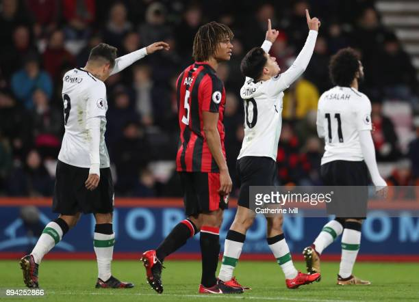 Nathan Ake of AFC Bournemouth look dejected as Philippe Coutinho of Liverpool celebrates after scoring his sides first goal during the Premier League...
