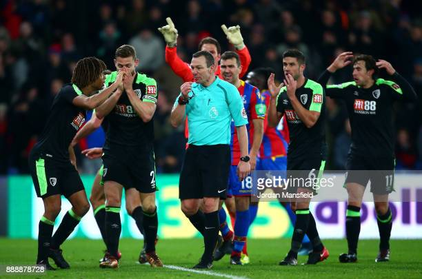 Nathan Ake of AFC Bournemouth reacts as referee Kevin Friend awards Crystal Palace a penalty during the Premier League match between Crystal Palace...