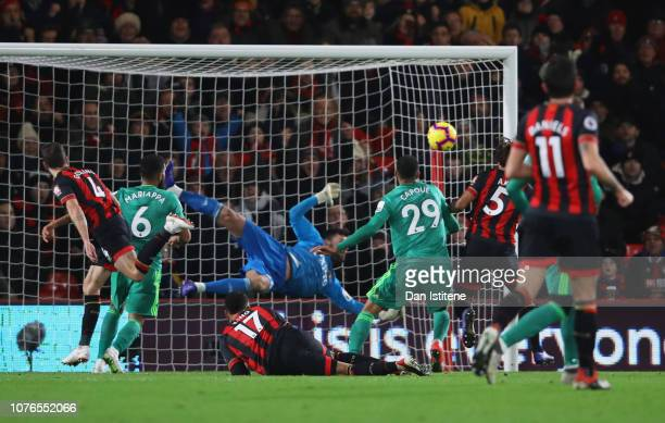 Nathan Ake of AFC Bournemouth scores his team's first goal past Ben Foster of Watford during the Premier League match between AFC Bournemouth and...