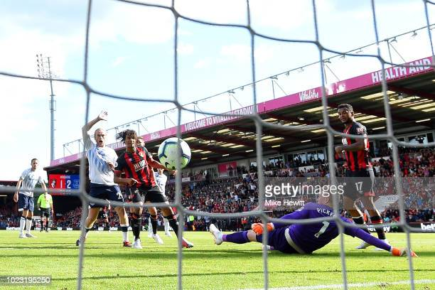 Nathan Ake of AFC Bournemouth scores his team's second goal past Jordan Pickford of Everton as Tom Davies of Everton appeals during the Premier...