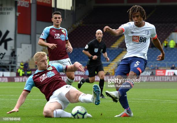Nathan Ake of AFC Bournemouth shoots under pressure from Ben Mee of Burnley during the Premier League match between Burnley FC and AFC Bournemouth at...