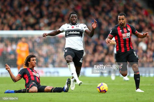 Nathan Ake of AFC Bournemouth tackles Aboubakar Kamara of Fulham during the Premier League match between Fulham FC and AFC Bournemouth at Craven...