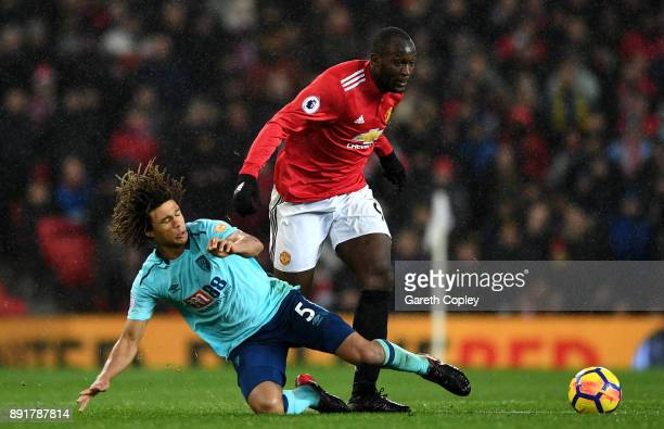 Nathan Ake of AFC Bournemouth tackles Romelu Lukaku of Manchester United during the Premier League match between Manchester United and AFC...