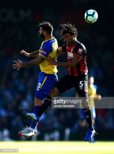 Nathan Ake of AFC Bournemouth wins a header over Charlie Austin of Southampton during the Premier League match between AFC Bournemouth and...