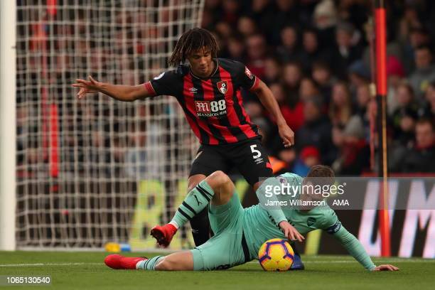 Nathan Ake of Bournemouth and Aaron Ramsey of Arsenal during the Premier League match between AFC Bournemouth and Arsenal FC at Vitality Stadium on...