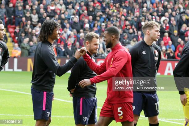Nathan Ake of Bournemouth and Georginio Wijnaldum of Liverpool the Premier League match between Liverpool FC and AFC Bournemouth at Anfield on March...