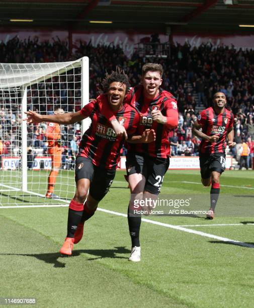 Nathan Ake of Bournemouth celebrates after he scores a goal to make it 10 with Jack Simpson during the Premier League match between AFC Bournemouth...