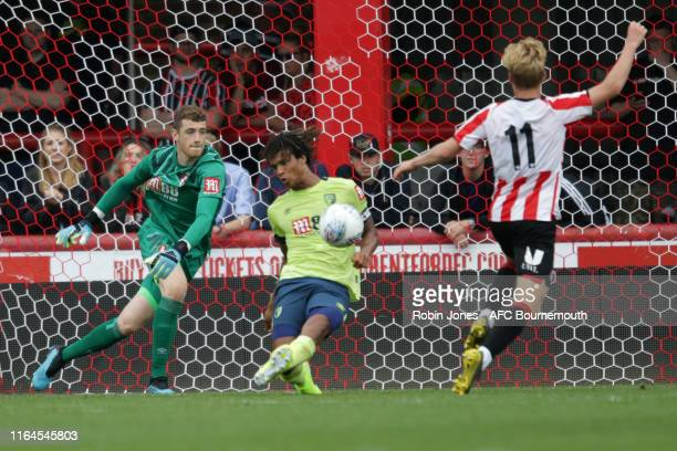 Nathan Ake of Bournemouth clears from Jan Zamburek of Brentford during the Pre-Season Friendly match between Brentford and AFC Bournemouth at Griffin...