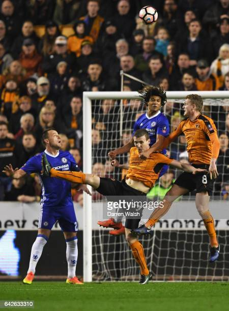 Nathan Ake of Chelschallenges wins a header over Jon Dadi Bodvarsson of Wolves during The Emirates FA Cup Fifth Round match between Wolverhampton...