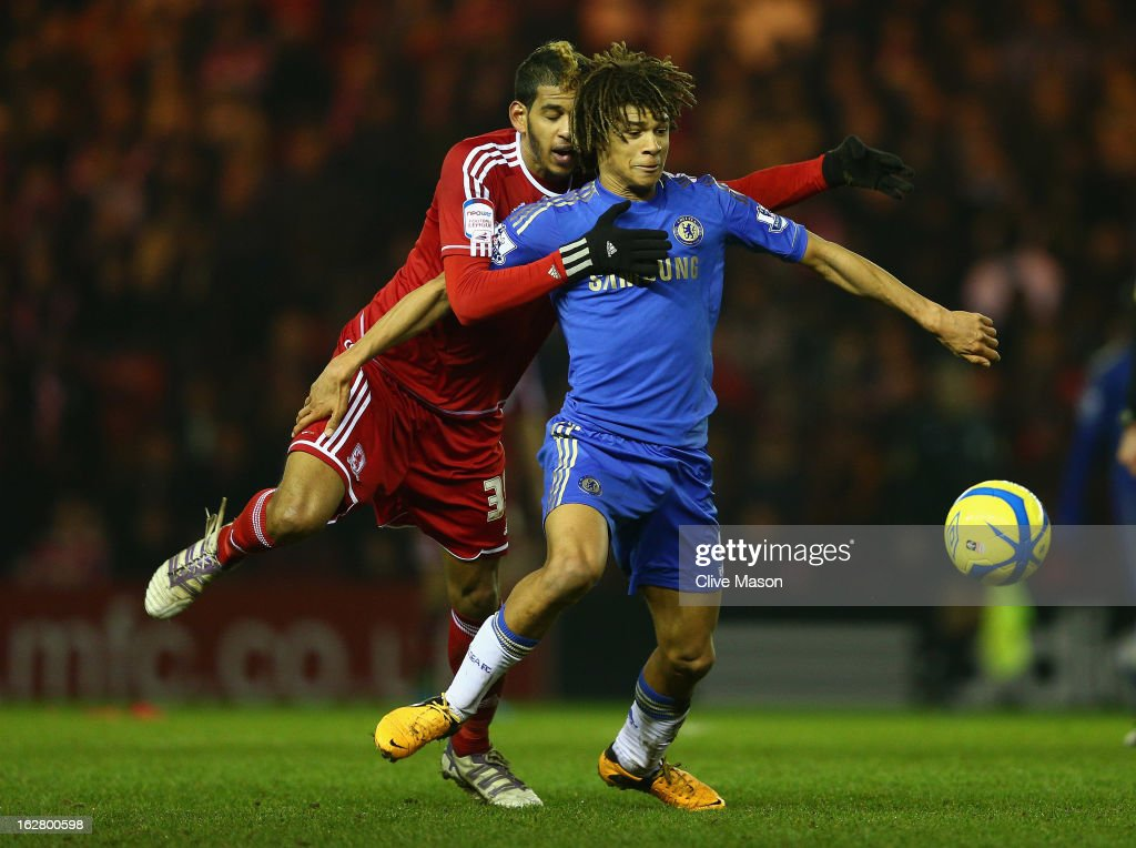 Nathan Ake of Chelsea is tackled by Faris Haroun of Middlesbrough during the FA Cup with Budweiser Fifth Round match between Middlesbrough and Chelsea at Riverside Stadium on February 27, 2013 in Middlesbrough, England.
