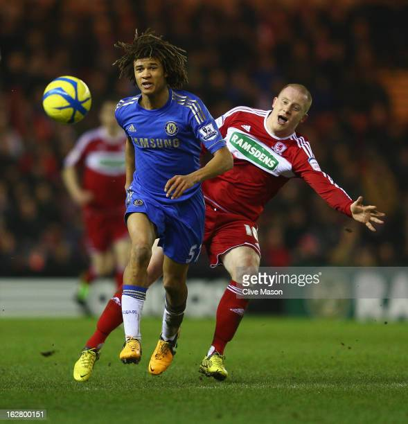 Nathan Ake of Chelsea is tackled by Nicky Bailey of Middlesbrough during the FA Cup with Budweiser Fifth Round match between Middlesbrough and...