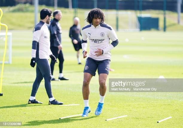 Nathan Ake of Manchester City in action during a training session at Manchester City Football Academy on April 13, 2021 in Manchester, England.