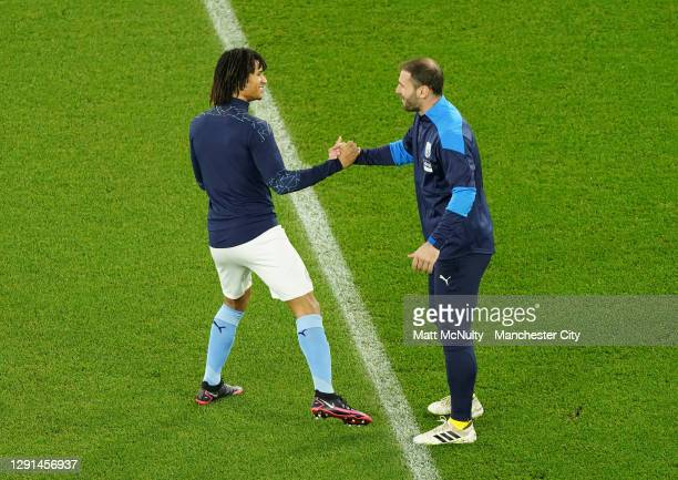 Nathan Ake of Manchester City shakes hands with Branislav Ivanovic of West Bromwich Albion prior to the Premier League match between Manchester City...