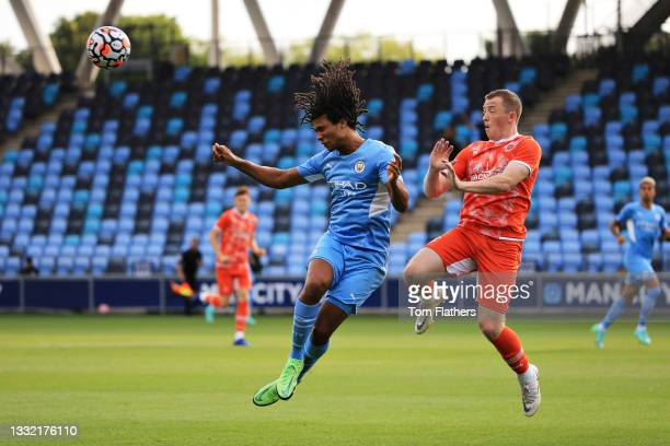 Nathan Ake of Manchester City wins a header during the pre-season friendly match between Manchester City and Blackpool at Manchester City Football...