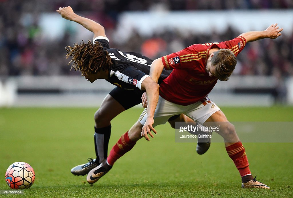 Nathan Ake of Watford and Jamie Ward of Nottingham Forest compete for the ball during The Emirates FA Cup fourth round between Nottingham Forest and Watford at City Ground on January 30, 2016 in Nottingham, England.