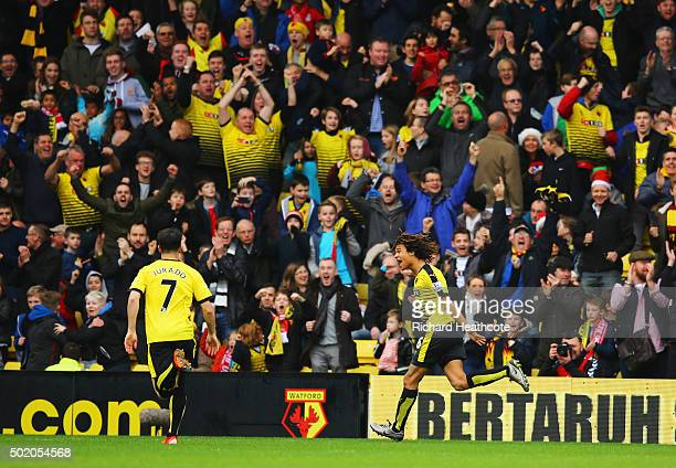 Nathan Ake of Watford celebrates in front of the Watford fans as he scores their first goal during the Barclays Premier League match between Watford...