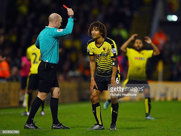 Nathan Ake of Watford is shown a red card by referee Anthony Taylor during the Barclays Premier League match between Watford and Tottenham Hotspur at...